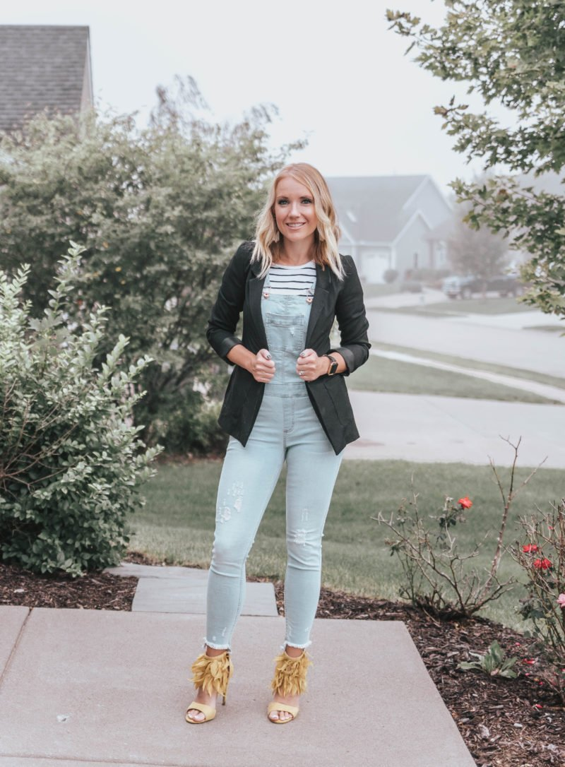 Spice up denim overalls with blazer, statement earrings, and statement heels