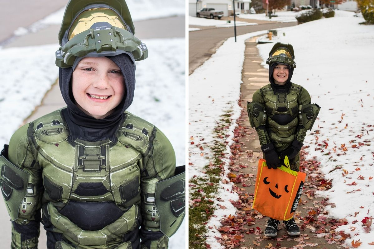 children's Halloween costume, a kid out trick or treating dressed as a soldier carrying an orange pumpkin bag.
