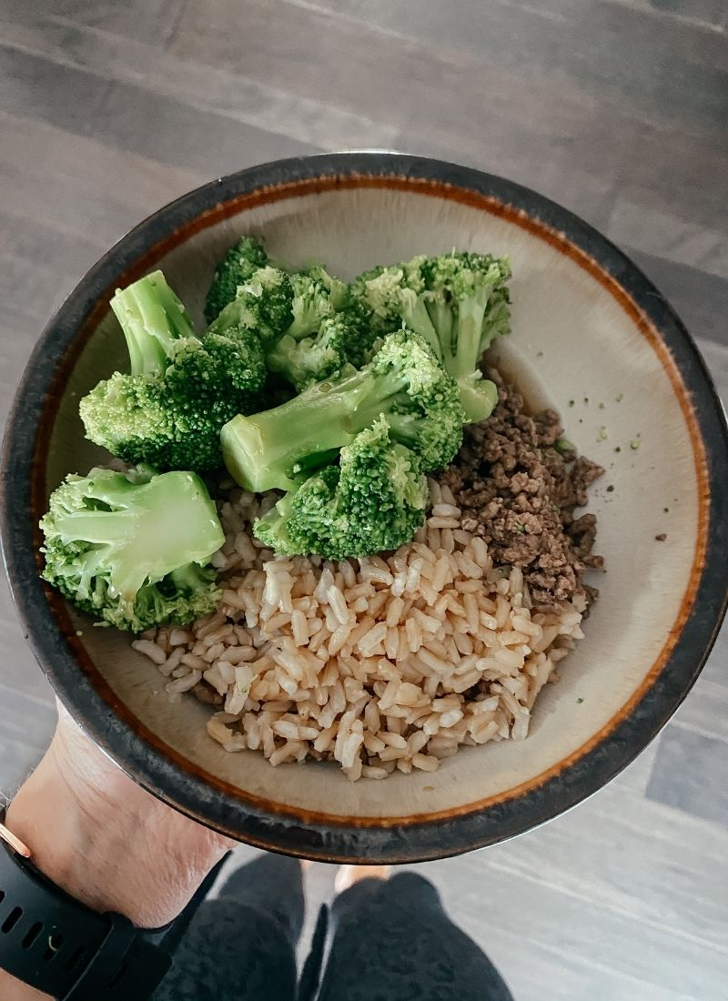 lean ground beef, brown rice, and broccoli stirfry in a bowl