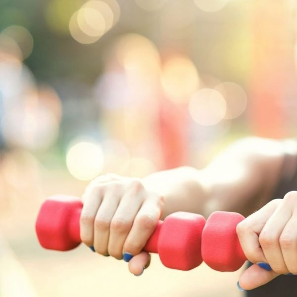 red dumbbells Christmas themed workout